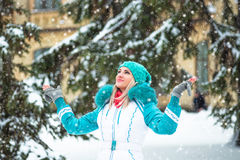 Young happy woman enjoy snow in winter city park outdoor Royalty Free Stock Photo