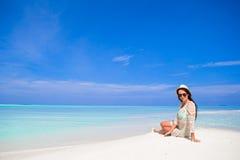Young happy woman enjoy tropical beach vacation Stock Photos
