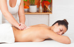 Young happy woman enjoying the massage Royalty Free Stock Photo