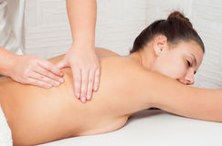 Young woman getting back massage Stock Photography