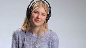 Young happy woman enjoying music with headphones. stock video footage