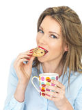 Young Happy Woman Enjoying Tea and Biscuits Stock Image