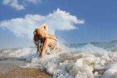 Young happy woman enjoying vacations on beach Stock Photos
