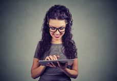 Content young woman using tablet royalty free stock images