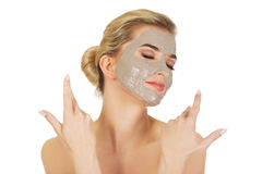 Young happy woman with facial mask. Young happy woman with facial mask, isolated on white Stock Images