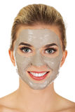 Young happy woman with facial mask. Stock Image