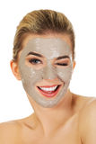 Young happy woman with facial mask. Young happy woman with facial mask, isolated on white Stock Image