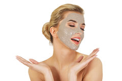 Young happy woman with facial mask. Stock Photos