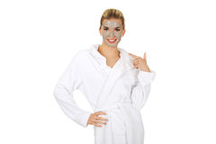 Young happy woman with facial mask. Royalty Free Stock Images