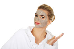 Young happy woman with facial mask. Royalty Free Stock Photo
