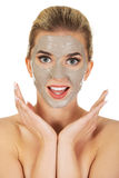 Young happy woman with facial mask. Royalty Free Stock Image