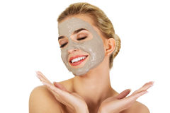 Young happy woman with facial mask. Stock Photo