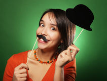 Young happy woman with  fake mustaches Stock Images