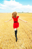 Young happy woman in field Royalty Free Stock Photos