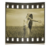 Young happy woman in field. Sepia Stock Photo