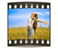 Young happy woman in field.  Stock Photography