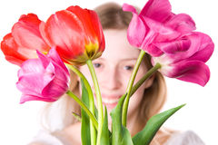 Young happy woman with flowers Stock Images