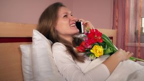 Young happy woman with flowers calling her man husband and thank for surprise stock video footage