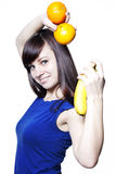 Young happy woman with fruits Stock Photography