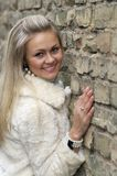 Young Happy Woman In Fur Coat Vertical Stock Photography