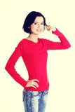 Young happy woman gesturing call me Royalty Free Stock Photos