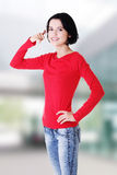 Young happy woman gesturing call me Royalty Free Stock Photo