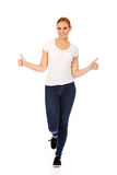 Young happy woman gesturing thumbs up Royalty Free Stock Photos