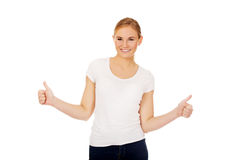 Young happy woman gesturing thumbs up Stock Photography