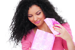 Young happy woman with a gift Royalty Free Stock Photos