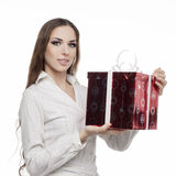 Young happy woman with a gift Stock Photos