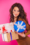 Young happy woman with a gift Royalty Free Stock Photo