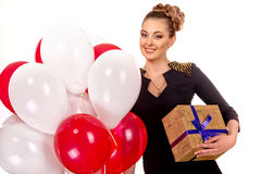 Young happy woman with a gift Royalty Free Stock Photography