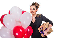 Young happy woman with a gift Royalty Free Stock Image