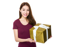 Young happy woman with gift box Royalty Free Stock Image