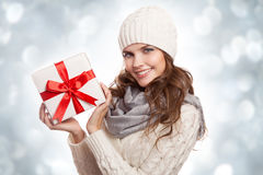Young happy woman with a gift. Christmas. Royalty Free Stock Images