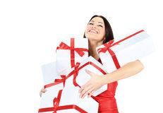 Young happy woman with a gift, closed her eyes  happiness and pleasure Stock Photo