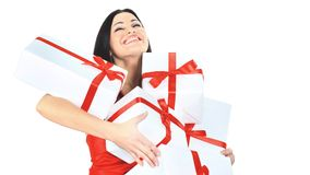 Young happy woman with a gift, closed her eyes  happiness and pleasure. Young happy woman with a gift, closed her eyes with happiness and pleasure isolated on a Royalty Free Stock Image