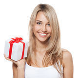 Young happy woman with a gift. Isolated Royalty Free Stock Photography