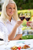 Young happy woman with glass of redwine Stock Images