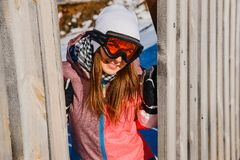 A young woman in glasses for winter sports. Young happy woman in glasses for winter sports royalty free stock image