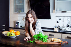 Young happy woman is going to prepare a salad Stock Photo