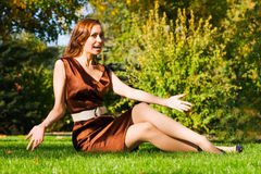 Young happy woman on grass Stock Photo