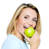 Young happy woman with green apple Stock Photos