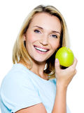 Young happy woman with green apple Stock Photography
