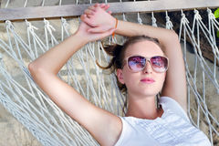 Young happy woman on a hammock Royalty Free Stock Photography