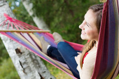 Young happy woman in hammock Royalty Free Stock Photography