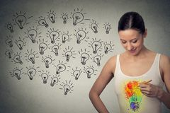 Young happy woman has a big idea Stock Photography
