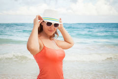 Young happy woman in hat on ocean coast Royalty Free Stock Photos