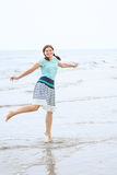 Young happy woman having fun and dancing on the beach of North S Royalty Free Stock Photo