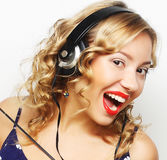 Young happy woman with headphones listening music Stock Images
